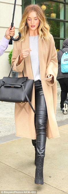 Rosie Huntington-Whiteley wearing Anita Ko Diamond Twisted Hoops, Neil Lane Cushion Cut Diamond and Platinum Engagement Ring, Alaia Embroidered Suede Ankle Boots, Saint Laurent Zip Detail Trousers, Babaton For Aritzia Thackary Sweater in Scotch and Celine Drummed Calfskin Small Belt Bag Black