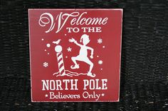 Hand painted wooden signs with arrows for North Pole, Reindeer Barn, and Santa's Workshop hanging from red and white grosgrain ribbon. Description from pinterest.com. I searched for this on bing.com/images