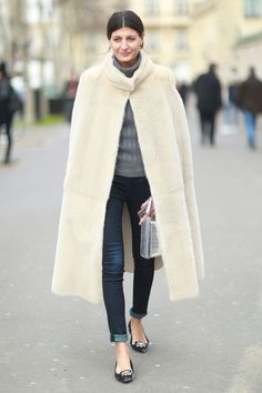 PFW Street Style: Giovanna Battaglia stayed warm with a luxe fur cape. Source: Tim Regas