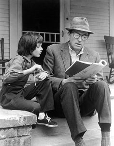 Gregory Peck reading to Mary Badham, the girl who played Scout in To Kill a Mockingbird.