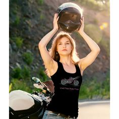 Live Free Ride Hard Rhinestone Motorcycle Tank Top, $14.70  This tank top is a must have for the biker girl that wants to show off her love of riding motorcycles. The motorcycle is made of pink and crystal rhinestone with crystal headlights shinning in the from and the phrase Live Free Ride Free spelled out in pink rhinestone below the bike. Order yours today-- http://www.zoeandeve.com