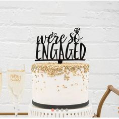We're So Engaged!! and show it off with this charming Acrylic Wedding Cake or Bridal Shower Cake Topper..great way to dress up your dessert table, your candy buffet and celebrate your engagement, bridal shower or bachelorette party.
