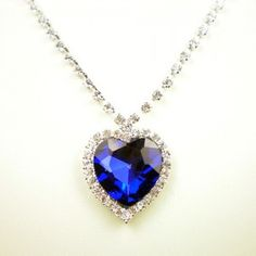"""Replica Heart of the Ocean Necklace is based on the stunning necklace worn by Kate Winslet in the 1997 movie """"Titanic"""". (Winslet's character, Rose DeWitt Bukater, was given the Heart of the Ocean necklace, by her fiance Caledon Hockley and she was wearing it when she supposedly drowned.The necklace was supposed to feature a large blue diamond once owned by Louis XIV: the Hope Diamond, also known as Le Coeur de la Mer."""