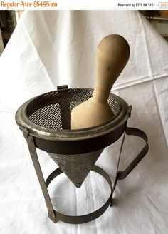 Vintage metal berry or tomato seive, with attached stand and handle and wooden pestle large rustic chic