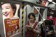 China is turning social media to suit its own needs. // Commuters ride the subway in Beijing. Mobile-device usage and e-commerce are in wide use in the Chinese capital despite serious restrictions on Internet access.