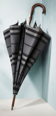 Shelter from the rain under a charcoal check umbrella from the Burberry S/S14 accessories collection