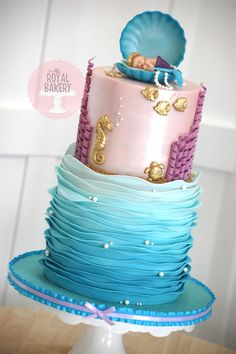 Baby mermaid cake with ruffle waves. Design by Cakes by RC.