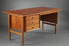 A sixties teck desk of a very classic and sober design. It is entirely made of teck veneering, the base is in massive teck. There are three drawers on the...