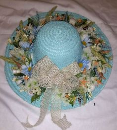Beautiful Seashell Hat Wreath by Color My World. Find it here: https://www.etsy.com/listing/269560103/beautiful-18-blue-seashore-straw-hat?ref=shop_home_active_3