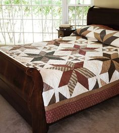 Using triangle-squares and snowball corners, you'll piece together this large quilt in no time!