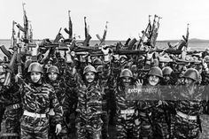 Soldiers of the Palestine Liberation Organization (PLO) jubilate after a military training in May 1967 before the six-day war.  On 05 June 1967, Israel launched preemptive attacks against Egypt and Syria. In just six days, Israel occupied the Gaza Strip and the Sinai peninsula of Egypt, the Golan Heights of Syria, and the West Bank and Arab sector of East Jerusalem (both under Jordanian rule), thereby giving the conflict the name of the Six-Day War. / AFP / -