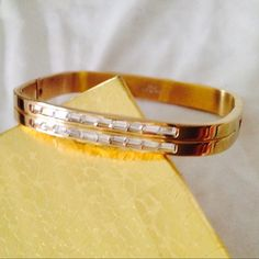 Beautiful, square bracelet with CZs High polished SS Gold Bonded bracelet with CZs.   Square bangle style opens for easy fit and clasp is hidden when closed. Jewelry Bracelets