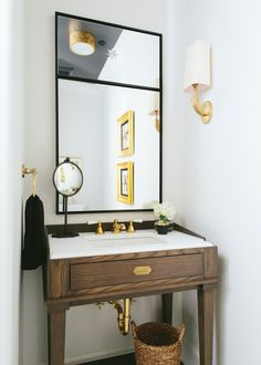 a modern neutral powder room by kate marker with wood black and white and brass | via coco kelley
