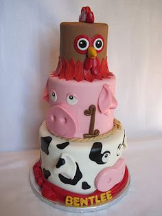 Farm Animals Cake- I think the pig and the cow are cute but the chicken is a little strange.