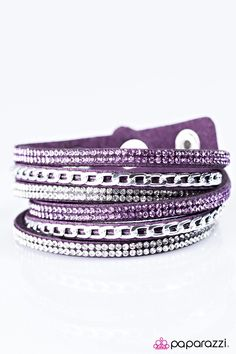 Put On Your Game Face Purple Wrap Around Bracelet. Three strands of purple suede are embellished with silver chain and white and purple rhinestones, creating a sassy display. The elongated band allows for a trendy double wrap design. Features an adjustable snap closure.