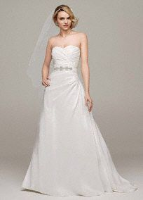Simple yet stunning, this taffeta gown is a timeless classic, perfect for the modern princess bride.  Sweetheart neckline is feminine and romantic.  Taffeta fabric shapes an elegant and flattering A-line silhouette.  Fully lined. Back zip