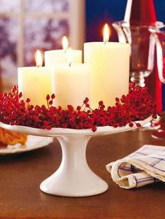 Red berries surrounding candles for a lovely Christmas Centerpiece.