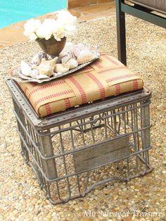 Metal milk crate turned footstool.  Love the jute webbing used!    from My Salvaged Treasures