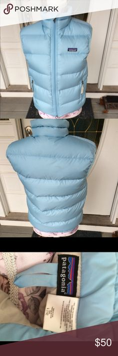 """Girl's Patagonia Vest size 12 or Women's small. Light Blue Down filled Patagonia girl's size 12 vest. Worn by my daughter inside the house twice. Beautiful Shade of blue- most like the first picture. Warm and snuggly. Very generous in size. Would definitely fit a woman's small. Measurements: armpit to armpit 19"""" and shoulder to bottom of vest 23"""". Patagonia Jackets & Coats Vests"""