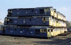 dozens of withdrawn British diesel locomotives and carriages stacked at Vic Berry's Scrapyard in Leicester .