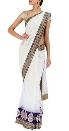 Sabyasachi, with a navy blouse...the blouse could be blue or something? I don't know but look at the white white saree! so pretty, man!