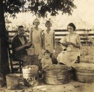 I so love this picture, as a family prepares to do some canning together.  The connection to the past is one of the main reasons a born & raised city girl like me has started canning.  It brings back memories of visiting my Nana & Papa in the country and walking through their almost endless garden and small orchard, gathering food to help can for the Winter. <3