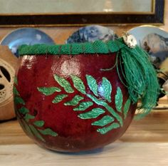 Carved Fern gourd bowl with burlap rim and antler button.
