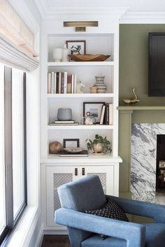 built-in shelves, statement fireplace