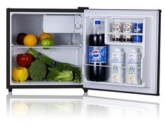 Stainless Refrigerator with Energy Star. Temperature range: (tested at Freezer ? / Fridge 34 to Features tall bottle door rack, removable shelf and adjustable thermostat. Compact Refrigerator, Dorm Necessities, Dorm Essentials, Shower Shoes, Living Room Plants, Hanging Picture Frames, College Room, Mini Fridge, Houses
