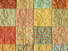 flower free-motion quilting...  I am pinning this for the proof that an interesting quilting pattern can make an otherwise plain patchwork quilt magical.