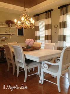 Dining Room Table & Chairs Painted White, Recovered in Burlap/Linen. Also like the floating shelves and chalkboard on a kitchen wall