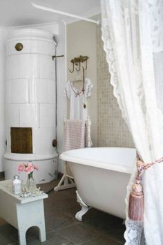 Shabby Chic-Love the Swedish tile stove in this bathroom
