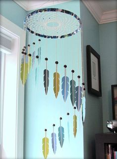 If you think the previous variations of this chandelier-like dream catcher is over the top, you can create this one with faux (or real) feathers hanging down.