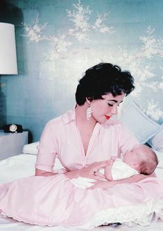 Elizabeth Taylor cradles her youngest son Christopher Wilding c. 1955