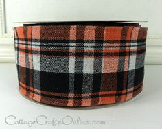 """Orange, black, and white woven plaid. 2 1/2"""" wide, with a linen like texture and a wired edge. From the Cottage Crafts Online shop on Etsy, where we help your ideas become creations."""