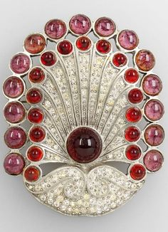 EISENBERG - An Art Deco metal and red rhinestone brooch, circa 1928/30. An Eisenberg Original. 7 x 8.5cm. #Eisenberg #ArtDeco #brooch