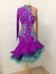 """Gorgeous and bright design from Annabelle designs. Stretch lycra and mesh with long sleeves. Perfect for all Latin and rhythm dances. Body suit and bra cups. Loads of Swarovski stones. Best for sizes from 4-8 and heights from 5'3"""" to 5'7"""""""