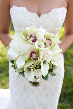 Cymbidium orchids, white mini callas and white roses. Simply elegant