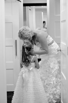 Touching bridal portrait of bride Tiffany Cook with her daughter and flower girl. Wedding planning and design by Tiffany Cook Events
