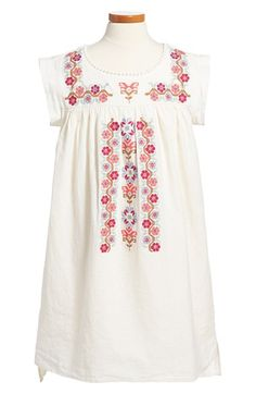 Free shipping and returns on Tea Collection 'Rosario' Floral Cross Stitch Dress (Toddler Girls, Little Girls & Big Girls) at Nordstrom.com. A floral cross-stitch design, gathered yoke and flat pom trim along the neckline lend a rich, heritage look to this lovely linen-and-cotton dress, while a high/low hem makes for a trend-right finish.