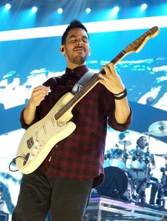Mike Shinoda Photos Photos - Singer/guitarist Mike Shinoda of Linkin Park performs onstage during the 2012 iHeartRadio Music Festival at the MGM Grand Garden Arena on September 22, 2012 in Las Vegas, Nevada. - 2012 iHeartRadio Music Festival - Day 2 - Show