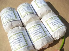 Sandwich with upgraded optional packaging: parchment paper wrap and upgraded label.