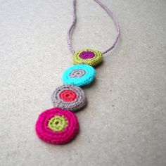 Cute finely crochet connecting polka dot jewels, to form a darling of a pendant.    Dotti hangs suspended through a blush\/latte crochet chain.    She is