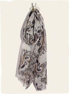 Stylized postmodern paisleys swirl on the gauzy wool scarf in soft, tonal hues.