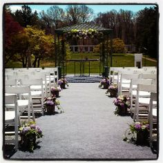 A glorious day for an outdoor wedding at Greystone Hall in West Chester Pa - the floral designs along the aisle will be re purposed into table centerpieces after the ceremony. www.perfectweddingflowers.com
