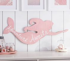 This hand-finished wall art exudes sea-inspired grace with a silhouetted mermaid and an inspiring message.