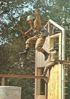 East German Soldier During Agility Drill German Soldier, German Army, East Germany, Berlin Germany, Border Guard, Army Police, Warsaw Pact, German Uniforms, Paratrooper