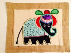 Elephant hand sewn table mat (or wall hanging) from Galle Fort, Sri Lanka. Made by the women of Shoba. Handmade Home Decor, Handmade Items, Textile Texture, Sri Lanka, Hand Sewing, Elephant, My Etsy Shop, Textiles, Disney Characters