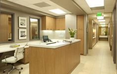 The nurses' station is centrally located across from all of the treatment rooms. Two windows with sliding obscure glass panels open up to the main reception area. A high-pressure laminate with solid surface countertops visually matches the finishes of the reception desk but with more cost-effective and durable products. Photo: Lisa Romerein