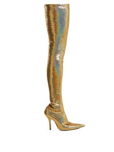 On Wednesday night, Michelle Obama stepped on stage in a pair of thigh-high Balenciaga glitter boots during the final stop of her Becoming book tour. Gold Boots, Metallic Boots, Glitter Boots, Michelle Obama, Balenciaga Boots, Balenciaga Spring, Thigh High Boots, Over The Knee Boots, Bootie Boots